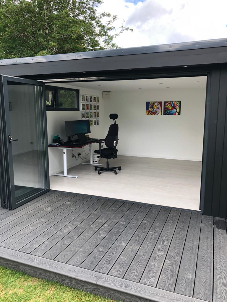black clad garden room with open doors